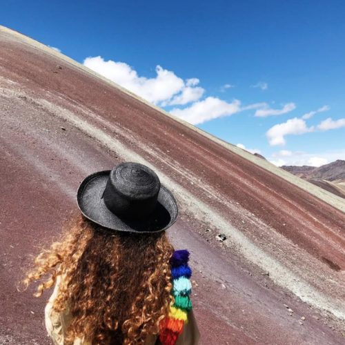 Woman wearing a hat in desert