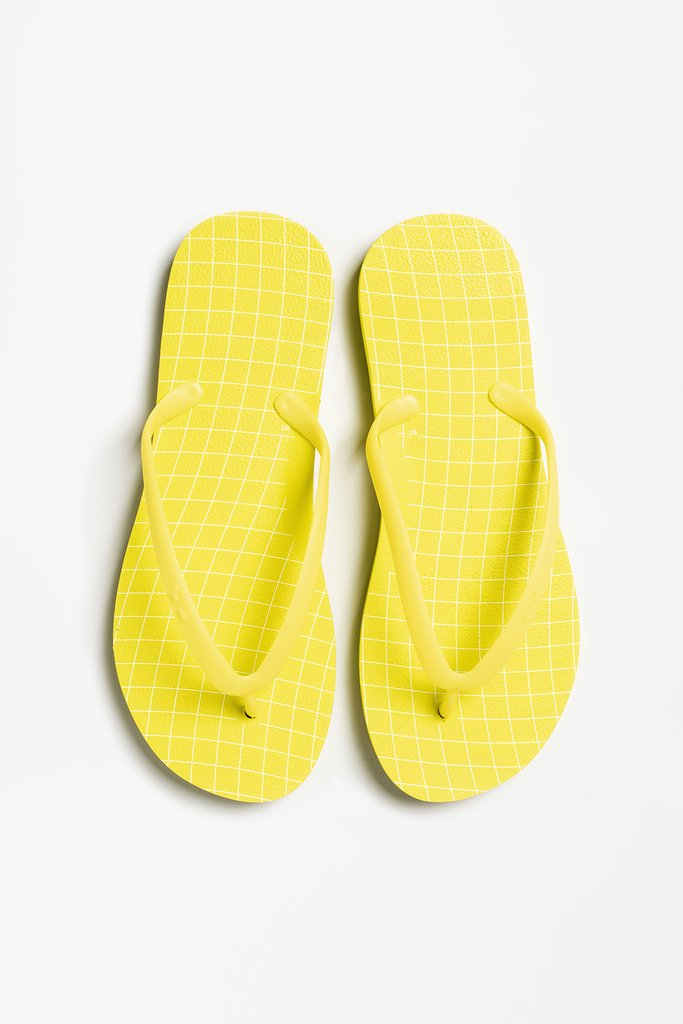 Comfy and durable Flip flops by Tidal New York are a must travel carry-on.