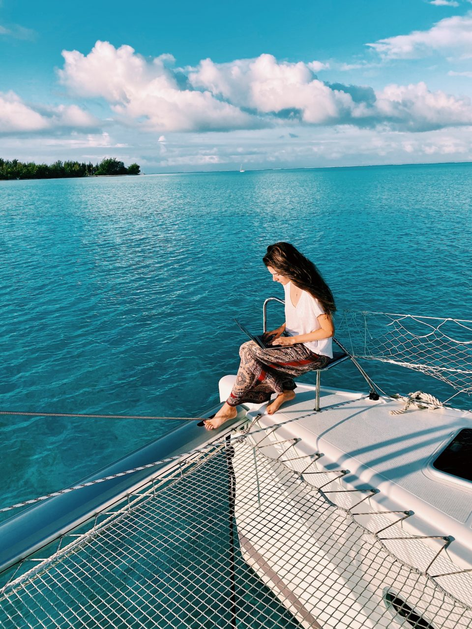 Dylan, the travel writer, writing about her experiences in the island of Bora Bora