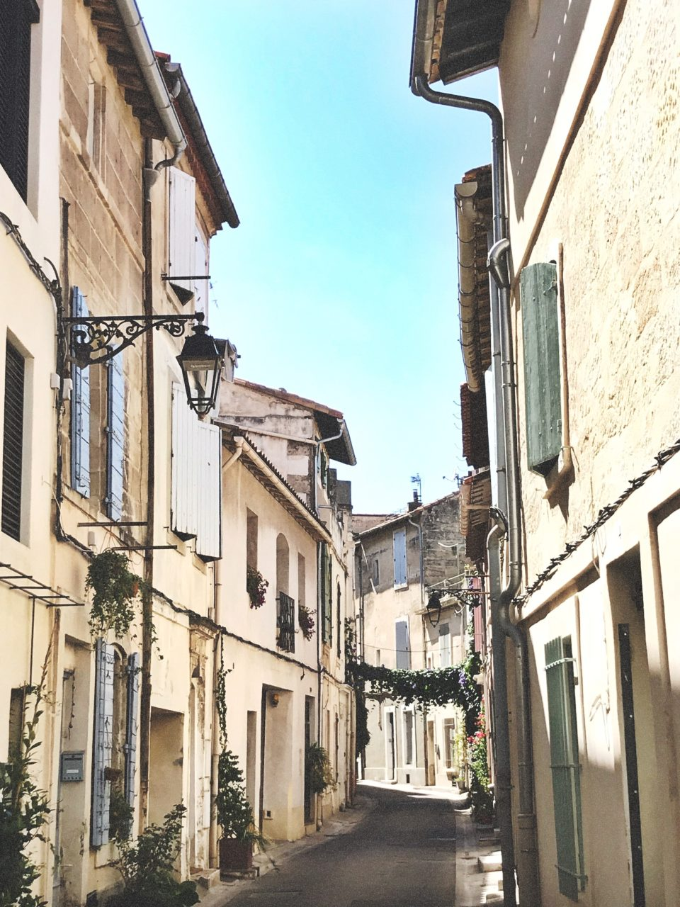A small stree with nearby apartments in the city of Arles, South of France.