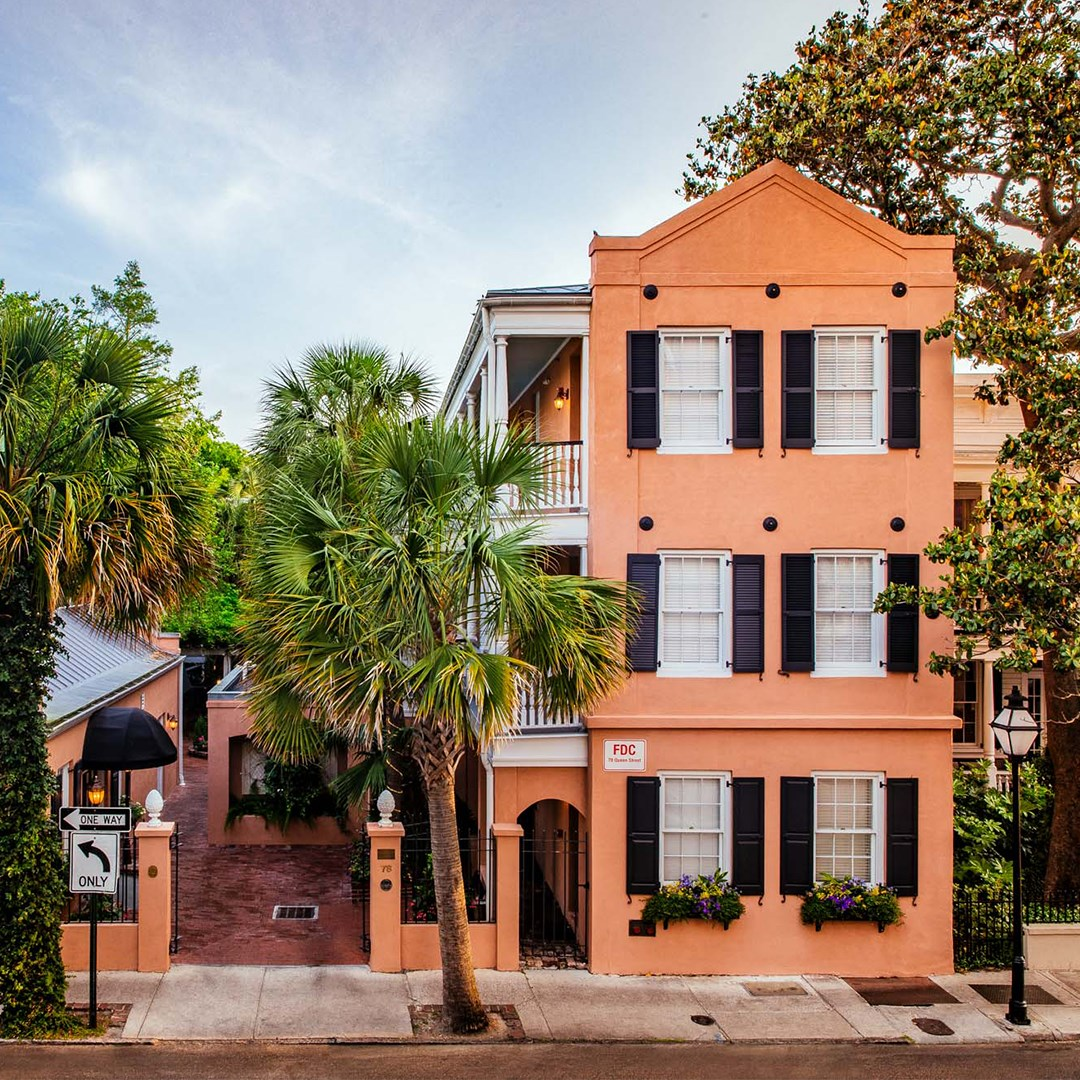 The peachy-orange Elliott House Hotel in Charleston.
